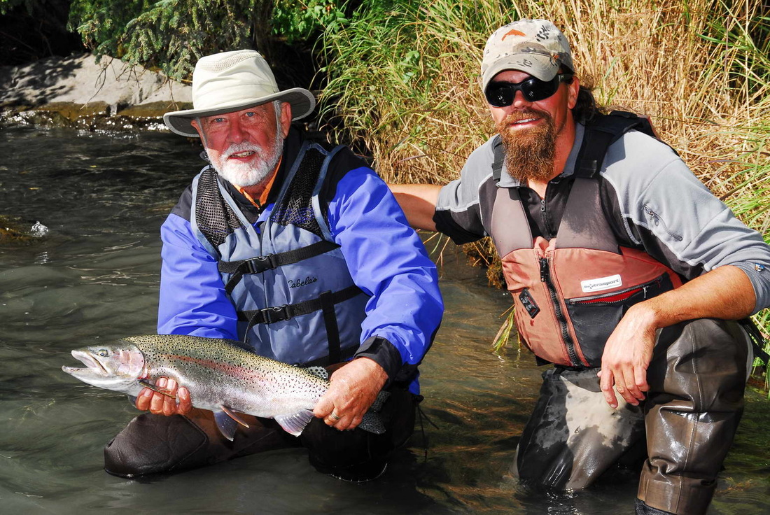 Fisherman and guide on the upper Kenai River with Rainbow trout.